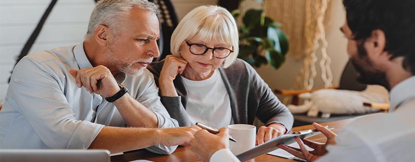 older couple receiving advice on finances
